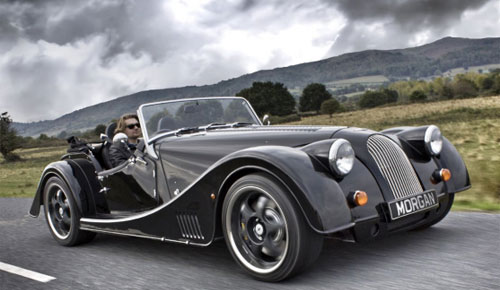 Morgan_Plus_E_Electric_Sports_Car_Classic_Look_Cute_Male_Model_Front_Right_Dandy_Gadget_Automotives